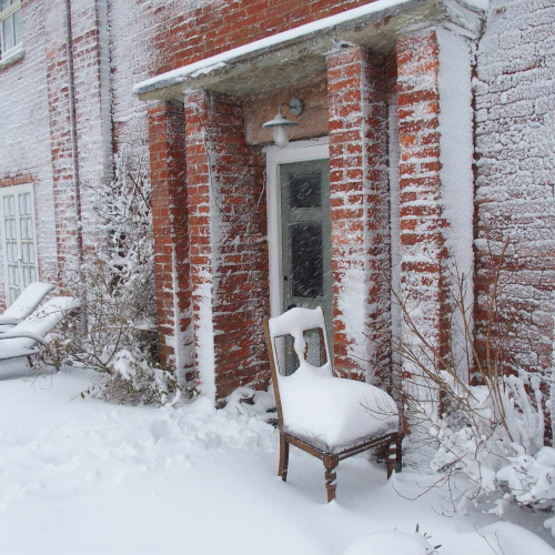 Chair in the wintery snow at Upper Heath Farm in South Shropshire