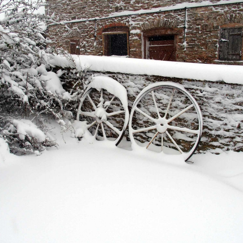 Wheels at Upper Heath Farm in the wintery snow, Self Catering house in Shropshire England